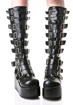 """Demonia Concord Buckle Platform Boots are ready to strap ya in for the time of yer lyfe. These hardcore knee-high boots are constructed from supa supple vegan leather and feature totally badazz double metal buckles on both sides of yer legz, 4"""" platform wedges and a full back zipper closure."""