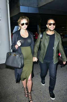 Chrissy Teigen and John Legend coordinate & win at matching couple outfits in olive green and black looks. See all of Teigen's best maternity looks here: