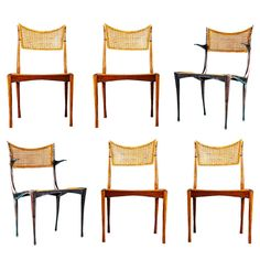 Dan Johnson Gazelle Chairs (Set of 6). Two Gazelle  Anodized aluminum arm chairs and Four Italian walnut side chairs with original caning. Handcrafted in Rome, Italy. Only few were made due to the high cost of production.