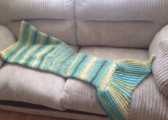 A personal favourite from my Etsy shop https://www.etsy.com/uk/listing/455540744/mermaid-tail-blanket
