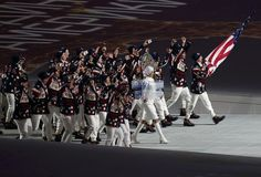 Flag-bearer Todd Lodwick of the U.S. leads his country's contingent during the athletes' parade at the opening ceremony of the Sochi 2014 Winter Olympic Games February 7, 2014. (REUTERS/Mark Blinch)