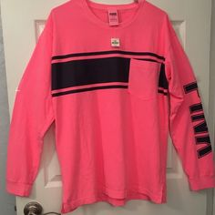 """VS PINK Campus Tee NWT Large  Victoria's Secret PINK Campus Tee.  Brand new with tags.  Size large.  Has pocket on front.  This is pink with navy blue detailing. See pictures. No trades.  No holds.  All offers (lowest ?'s) via make """"offer"""" button only please (reasonable offers).  Thanks for looking and Happy Poshing! :) PINK Victoria's Secret Tops Tees - Long Sleeve"""