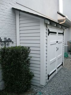 small storage for along the side of a house, outdoor living, shelving ideas, storage ideas, A small but attractive shed set along the side of a house With some shelves it can store quite a bit all with easy access
