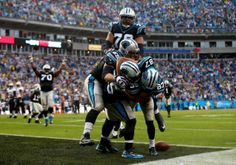 CHARLOTTE, NC - DECEMBER 22: Domenik Hixon #87 of the Carolina Panthers makes the game winning touchdown in the fourth quarter to defeat the New Orleans Saints 17-13 as he celebrates with teammates Mike Tolbert #35, Jordan Gross #69 and Nate Chandler during their game at Bank of America Stadium on December 22, 2013 in Charlotte, North Carolina. (Photo by Streeter Lecka/Getty Images)