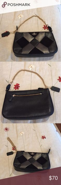 Small Coach Leather Bag Small Coach leather bag, can be used as a shoulder bag or as a wristlet with gold chain strap.  Has patches if black suede on the front also. In excellent condition, only used once.  Measurements are 9.5x5.5.  Really adorable! Coach Bags Clutches & Wristlets