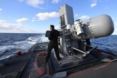 Fire Controlman 2nd Class Spencer Bagwell, assigned to the guided-missile destroyer USS Porter (DDG 78), conducts maintenance on a SeaRAM close-in weapon system. U.S. Navy photo by Mass Communication Specialist Seaman Ford Williams