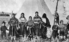 L-R: William Wagner, wife of Coming Singer, Pipe Woman, Daylight Takes A Gun, unidentified, Only Killer, unidentified, unidentified, daughter of Long Time - Blackfoot (Kainai). Blackfoot Digital Library.
