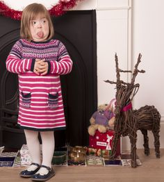 That's what I think of Christmas in June! Natty, model with Down syndrome, tells the photographer just what she thinks of him!
