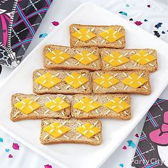 "These toast snacks scream style with an ""argyle"" pattern of sliced cheese and cream cheese!"