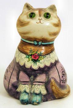 """Джоан и Дэвид Де Вефиль (Льюиса, Суссекс) - Папье-маше кошка с зелеными стеклянными глазами, украшенные со стихом """", когда все Грим, удачи, я принесу"""", 6.75ins высокой, № 198 (вписанные и датирована 1963 на базу - несколько повреждены) Руководство Цена: £ 150-200 Номер лота: 794, 14 сентября 2010 продан за: £ 420   Кентербери Auction Galleries"""