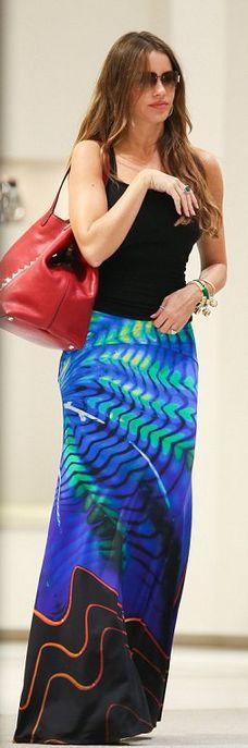 Red studded handbag and print long skirt