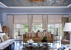 Roman shades and draperies - lovely....but this look can work with any hard window covering.