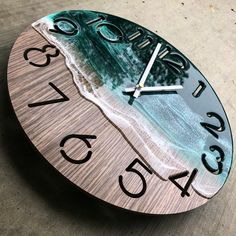This is the first clock that @createdbyjenni made that has numbers on / in it. She really didn't want to stick numbers on the beach scene,…