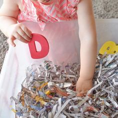 """Alphabet Hunt Shredded Paper Sensory Bin for Toddlers & Preschoolers! ♻️ ~ Working on sibling social skills with this recycled Sensory Bin using shredded newspaper & foam letters. Through this simple activity, we're learning to work & play together and use our words & manners (as well as colour recognition + letter recognition & sequence)! Miss22m searched for foam letters through the tub of shredding newspaper (this is where I jump in with the """"You found the red D"""
