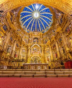 High altar and dome of the Roman Catholic church and Monastery of St. Francis, Quito, Ecuador. The monastery complex, the largest architectural ensemble among the historical structures of colonial Latin America, was completed in the 16th century. Construction took 150 years, and the building exhibits a mixture of architectural styles.