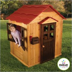 Outdoor Playhouse made of weather resistant wood, with working doors and windows.