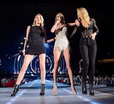 May 30: Gigi Hadid and Martha Hunt perform along with Taylor Swift on stage during the 1989 World Tour Live at Ford Field in Detroit, Michigan.