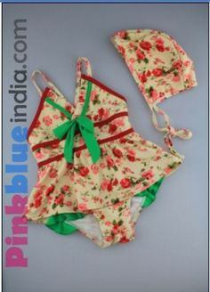 a12355be477e Buy the beautiful swim wear in off white color with red flower prints all  over the