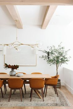 Modern Lake House: Entry & Dining Photo Tour Neutral dining room with pop of color thanks to earthy ochre hued dining chairs Dining Room Curtains, Dining Room Lighting, Dining Room Table, Console Table, Dining Rooms, Dining Chairs, Room Rugs, Curtains Living, Modern Dining Table