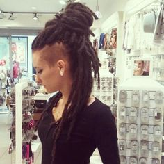 dread bun w/ undercut.. I don't think I would ever get dreads, but this is gorgeous.