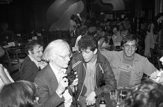 Andy Warhol, left, Reed and Danny Fields in 1978