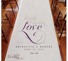 Customized aisle runner...love it! Don't forget the rose petals ;-)