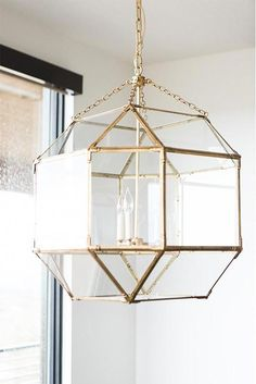 The Morris Lantern is an over-sized lantern that is ready to make a statement! It combines iron edges and glass panels in the perfect modern combination. Entry Chandelier, Lantern Chandelier, Industrial Chandelier, Contemporary Chandelier, Pendant Chandelier, Fire Pit Lighting, Entry Lighting, Entry Way Lighting Fixtures, Circa Lighting