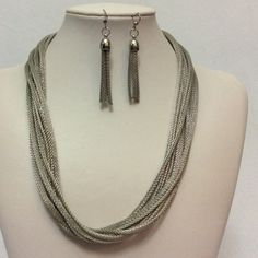 Metal mesh necklace and earrings set. Silver toned multi strand metal mesh necklace and earrings set. Jewelry Necklaces