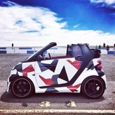 A very convenient car especially if you problems with parking space. Geometric smart car.