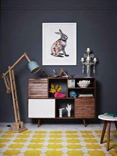 Love the blue-grey wall colour, floor lamp and rabbit  art work.