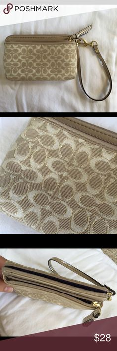 Coach Beige Wristlet Beige Coach wristlet with coach logos on main part of wallet, small leather portion at the top. Cream logos are lined with a little bit of gold. One outside zipper pocket. Purple interior with three card slots. Detachable wrist strap. Used but still in great condition. Coach Bags Clutches & Wristlets