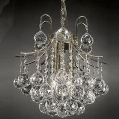 @Overstock.com - Indoor 3-light Crystal/ Silver Mini Chandelier - With its dramatic design and sparkling materials, this stunning miniature crystal chandelier will add instant style to any room. The large cascading crystals create sparkling reflections, and the compact design works well in smaller spaces.  http://www.overstock.com/Home-Garden/Indoor-3-light-Crystal-Silver-Mini-Chandelier/5326570/product.html?CID=214117 $99.99