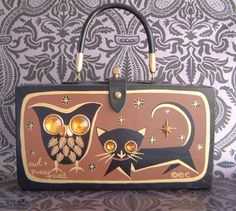 Riffy has a version of this vintage Owl & Pussycat purse by Enid Collins.