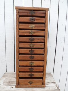 interesting cabinet. cedar. measures 25 H 9.75 W. each box measures 7 1/2 by 7 1/2.