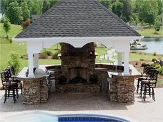 With a built-in fireplace and an outdoor TV this is the ultimate outdoor paradise.  A pavillion roof protects the cook and guests from excess sun or rain. This is a family you want to be friends with!