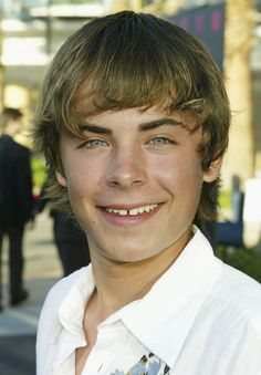 When they made their awkward debut alongside his gap teeth but we fell in love with them anyway. | The 19 Most Fabulous Moments From The Life Of Zac Efron's Bangs