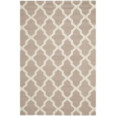 Grace your living room or bedroom with this contemporary hand-tufted rug. This hand-made rug features a Moroccan-inspired design and a high-low construction. Equipped with a cotton canvas backing, this piece will serve your home for years to come.