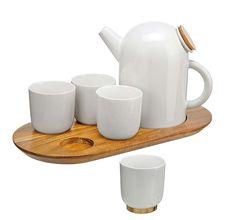 Service à thé comprenant un lot de 4 tasses et théière, en porcelaine. ©Sia Home Fashion