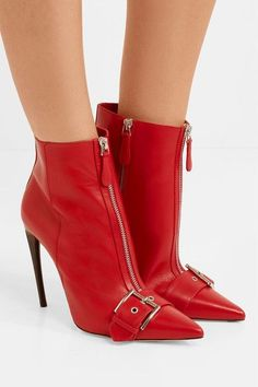 7a9e22696058 Alexander McQueen Buckled leather ankle boots Heel measures approximately  inches Red leather (Calf) Zip fastening along side Made in Italy