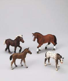 Schleich models top left to right •Black forest yearling •Hanoverian mare •Tennessee Walker foal •Knabstrupper foal