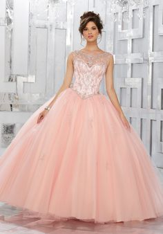 This Classic Quinceañera Ballgown Perfectly Combines a Stunning Illusion Jewel Neckline and Beaded Bodice, with a Full Ballgown Skirt Accented with Delicate Beading. Matching Stole Included. Colors Available: Champagne/Light Purple, Blush, Fuchsia, White.