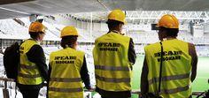 Karin Wanngård (S), Roger Mogert (S) och Tomas Rudin (S) besöker Tele2 Arena i juni 2013. Nästan klart för invigning, men fortfarande en byggplats.