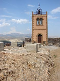 Bell tower built on the remains of Seron Castle, once a Moorish stronghold, Almeria, Spain.