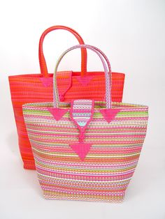 Senegal Rose Tote Bag. Carry this tote on your next picnic and pack enough strawberries and wine for a long afternoon.  These versatile, hand-woven bags are great for trips to the beach or picnics in the park. Use it as a decorative shopping bag or to tote your schoolbooks. Each tote bag is made from a traditional, West African basket weave, and gives you bohemian chic style. Artist: Mamadou Kieta  Made in: Senegal. $22.00