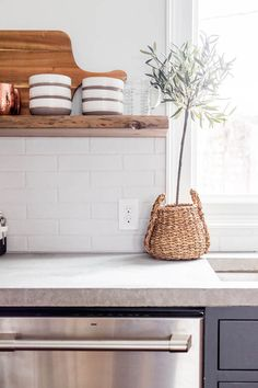 Cement countertops and black inset cabinetry help create blogger Ashley of Cherished Bliss's rustic modern kitchen.