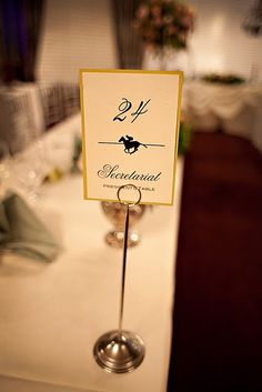 tables named after the horses or past derby winners.use spray painted wine bottles and corks for holders