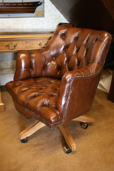 A Williams Swivel Chair Tan Leather Oned Upholstery Oak Base