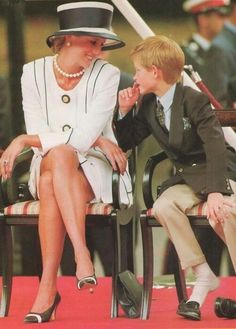 Princess Diana and Prince Harry. Love the glance and how he's kicked off his shoes.