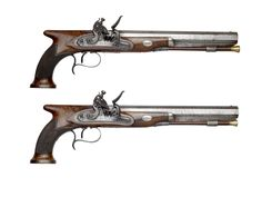 Pair of saw-handled flint-lock duelling pistols