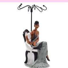A collection of figurines and jewelry holders featuring African American women in glamorous and elegant attire....